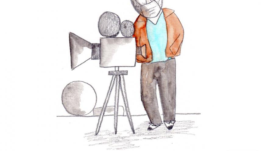 Dibujo de un hombre con una cámara de cine