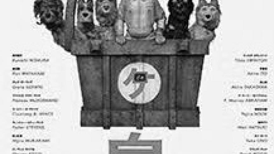 IMAGEN DEL CARTEL DE LA PELÍCULA ISLA DE PERROS EN LA QUE SE VE UN NIÑO RODEADO DE CINCO PERROS