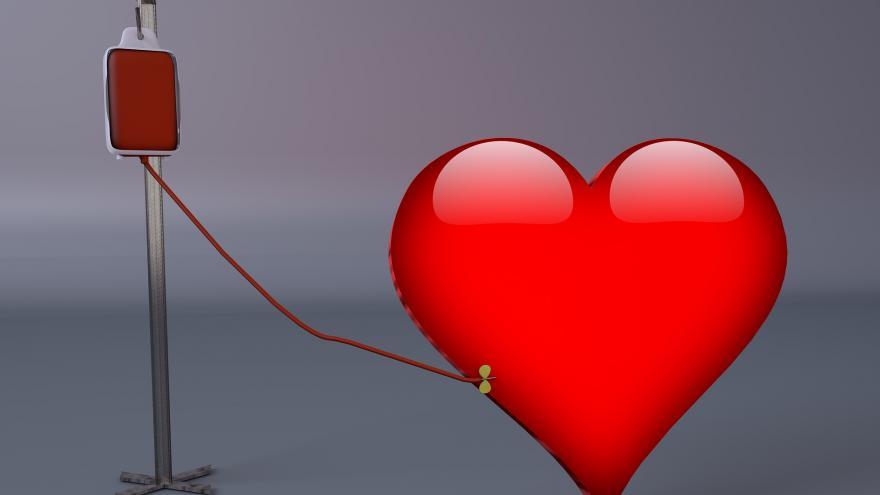 Un corazón unido a un gotero