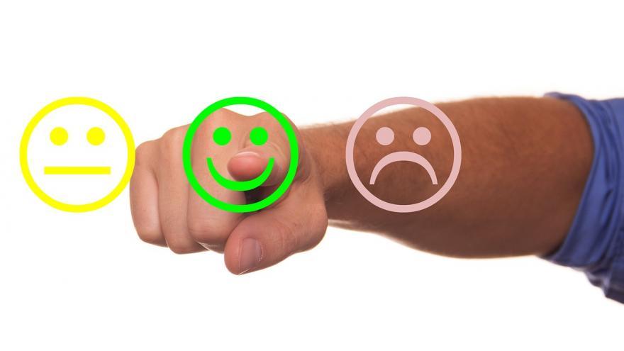 Tres caritas para marcar grado de satisfacción en encuesta