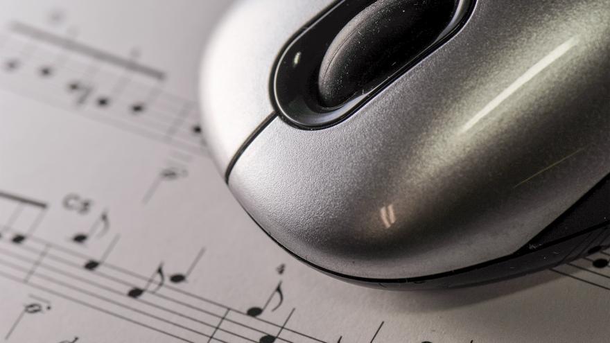 Ratón sobre partitura