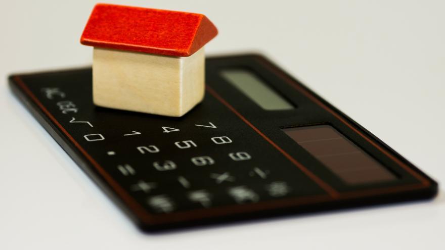 Imagen de calculadora con casa