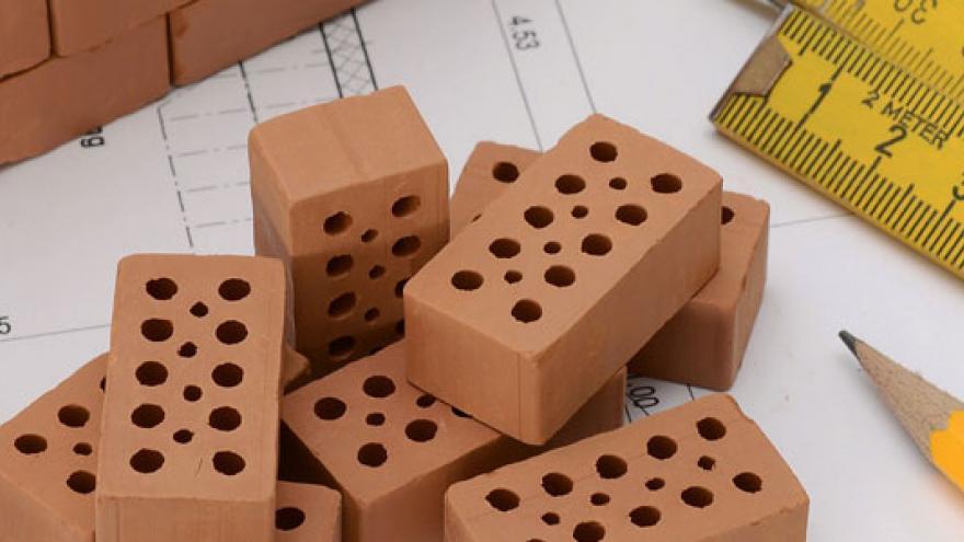 Ladrillos y planos de casa
