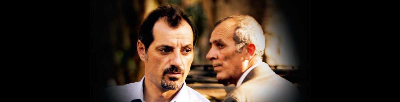 portada de la película El insulto en la que se ve a dos actores en primer plano