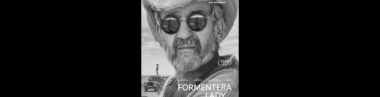 imagen del cartel de la película Formentera lady en la que se ve un primer plano del actor con sombrero y gafas de sol