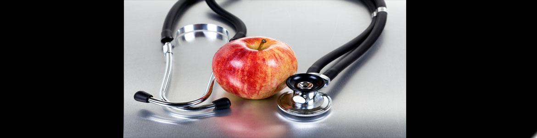 Manzana y estetoscopio