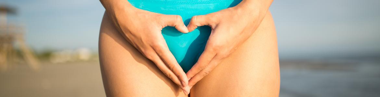 imagen del vientre de una mujer y las manos formando un corazón