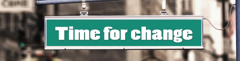 Cartel en la calle que pone Time for change