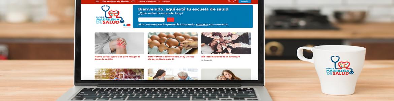 Ordenador portátil con la portada de acceso a la Plataforma de cursos online de la Escuela de Salud de la Comunidad de Madrid
