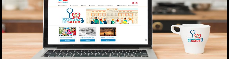 Ordenador portátil con fondo de pantalla con el logo de la Escuela Madrileña de Salud