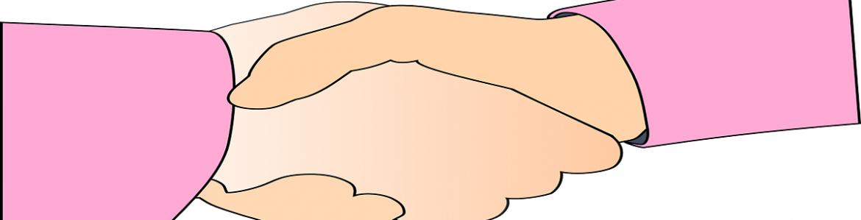 Apretón de manos con las mangas del jersey de color rosa
