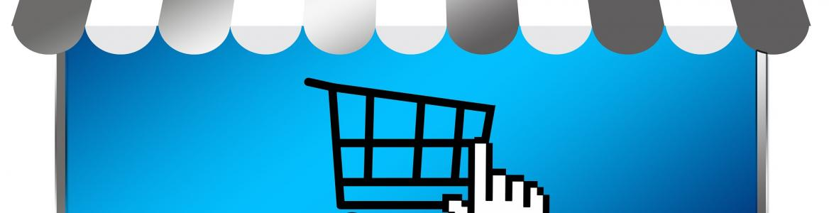 icono de carro de la compra sobre pantalla de ordenador con toldillo de tenderete