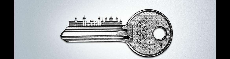 Logotipo Plan Alquila; llave con skyline de Madrid