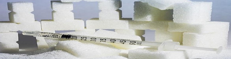 jeringa de insulina con terrones de azúcar