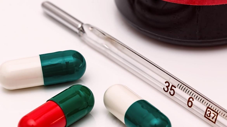 Termómetro y píldoras