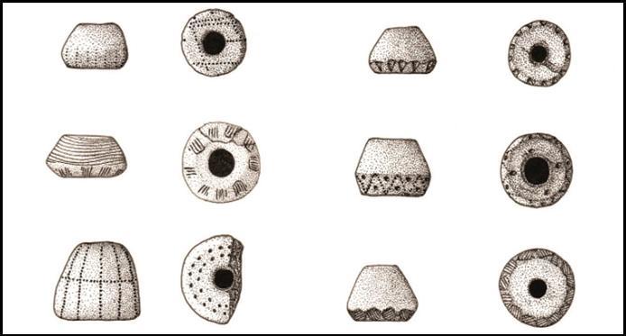 Imagen ejemplos de fusayolas del yacimiento de la Fuente de la Mora