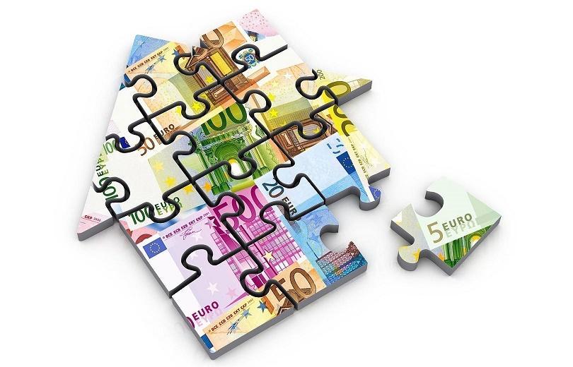Imagen de una casa en puzzle