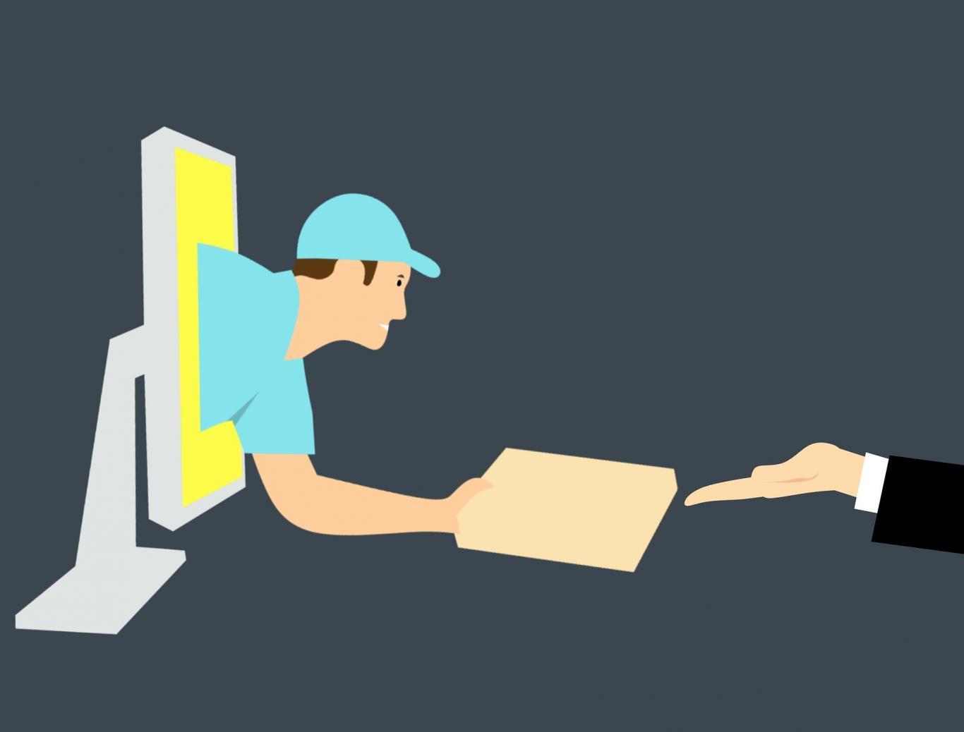 hombre saliendo del ordenador con paquete