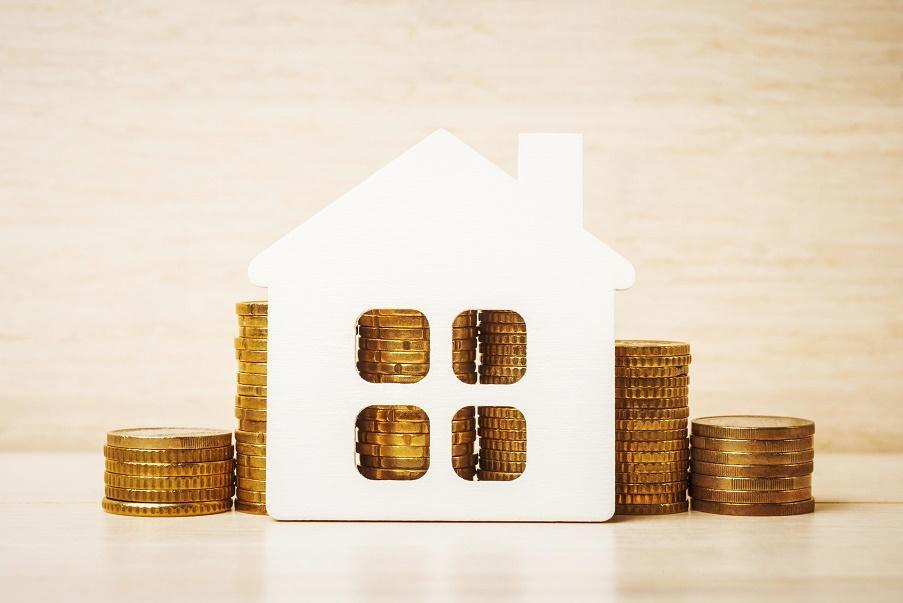 Imagen de una casa con monedas