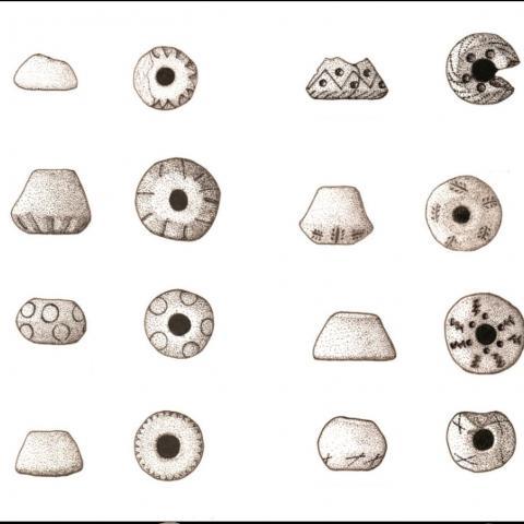 Imagen de Fusayolas del yacimiento de la Fuente de la Mora